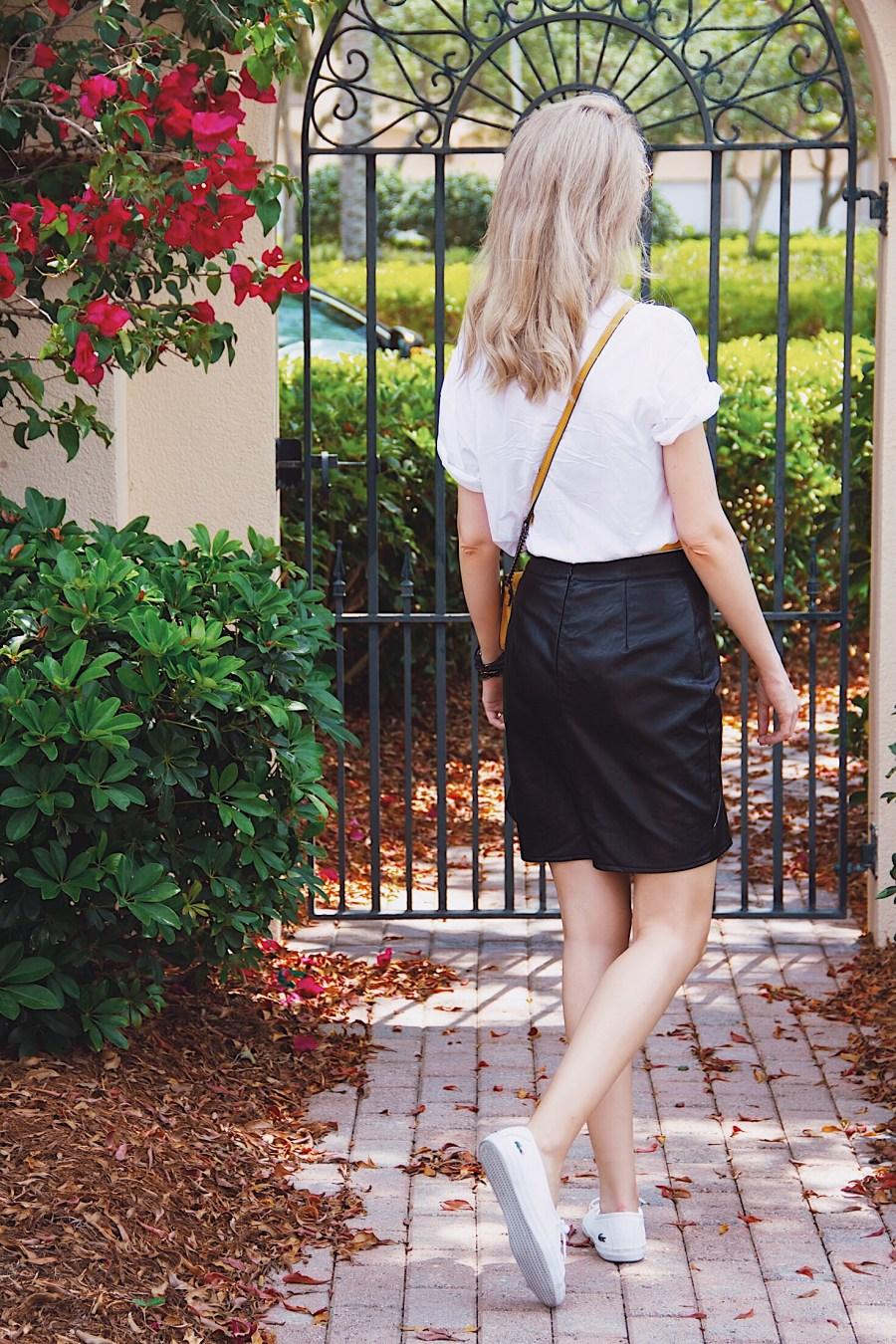 I am the Boss Graphic Tshirt Black ruffle skirt mustard bag white Lacoste sneakers