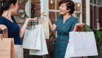 happy women joying after shopping in store