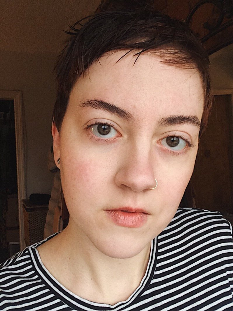 A typical daily makeup look, with Glossier Boy Brow and Haloscope, plus  The Body Shop Powder Foundation , Physician's Formula Blush, and  Clinique Black Honey  Lip color
