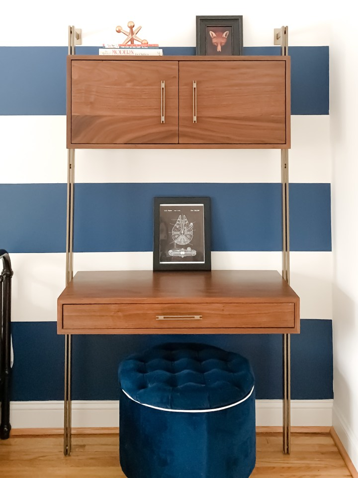Styling Gypsy Interior Design | Classically Cool Boys Room reveal featuring a blue and white striped accent wall, mid-century wall desk, vintage art, star wars art prints, navy blue storage ottoman #boysroom #boysroomideas #boysroominspiration #starwarsbedroom #boysroomdecor #kidsroom