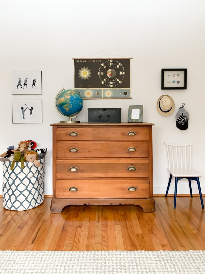 Styling Gypsy Interior Design | Classically Cool Boys Room reveal. Vignette features a vintage wood dresser with aged brass pulls, vintage globe, moon chart art print and plush beige and ivory wool rug #boysroom #boysroomideas #boysroominspiration #starwarsbedroom #boysroomdecor #kidsroom