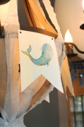 Whale banners hung on chandelier