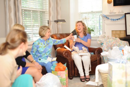 The mom-to-be opening gifts