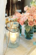 Mason jars served as candle holders and flower vases