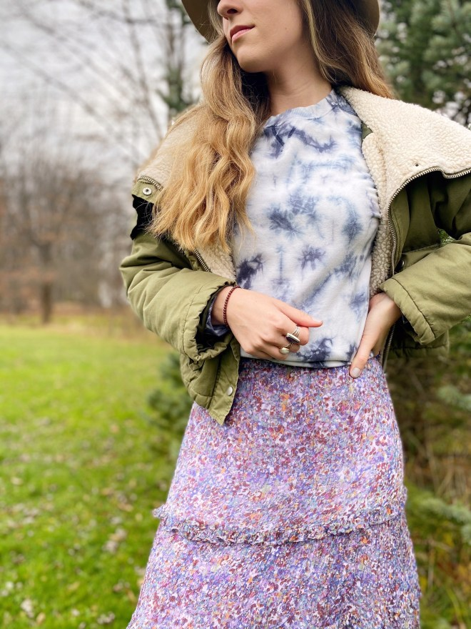 Tie-dyed sweatshirt with floral skirt.