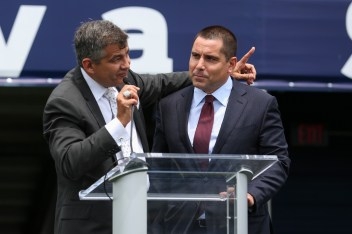 Pete Garcia, left, and Riccardo Silva talk during a press conference in Florida International University's newly renamed Riccardo Silva Stadium in Miami, Florida on April 3, 2017.