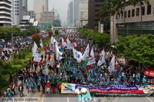 Massa buruh dari berbagai organisasi buruh merayakan Hari Buruh Internasional 2014 di depan Istana Negara RI, Jakarta Pusat. Kamis (01/05/2014). (Foto: Pasha Aditia Febrian)