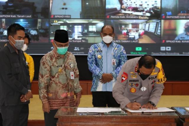 Penandatanganan MoU Polda Kalsel antara Pemerintah Provinsi Kalimantan Selatan dan Pemerintah Kabupaten Kota se Kalsel