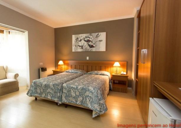 Imagem do Suite com Duas Camas na Pousada Nacional Inn em Onde ficar em Campos