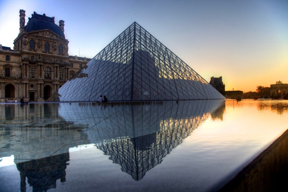 "A tone mapped ""HDR"" image of the Louvre Pyramid reflecting pool on a late afternoon in Paris."