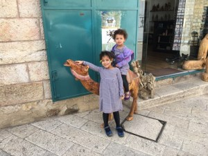 Travel with Kids - posting outside of a shop in Bethlehem