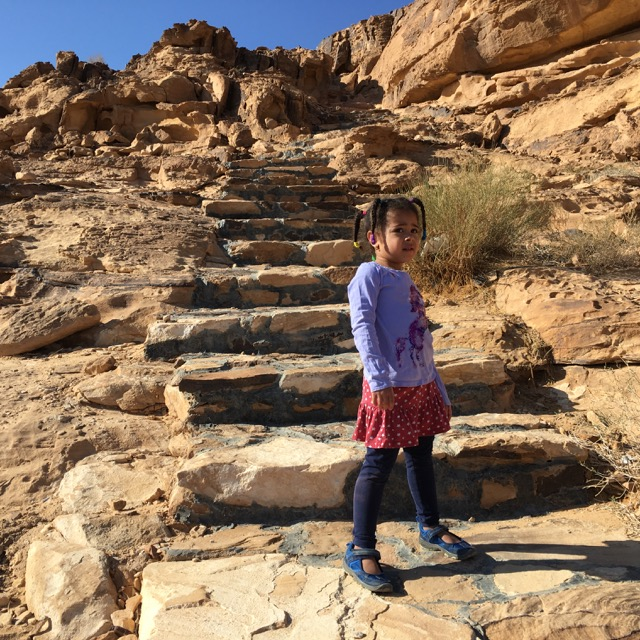 """Travel with Kids - Jasmine, intrepid explorer, about to climb the hill above our """"camp"""" in Beit Ali"""