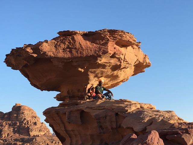 Travel with Kids - Bertrand and Jasmine under the mushroom rock in Wadi Rum