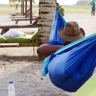 Bertrand relaxing in his hammock at Sipopo Beach, Bioko Island, Equatorial Guinea