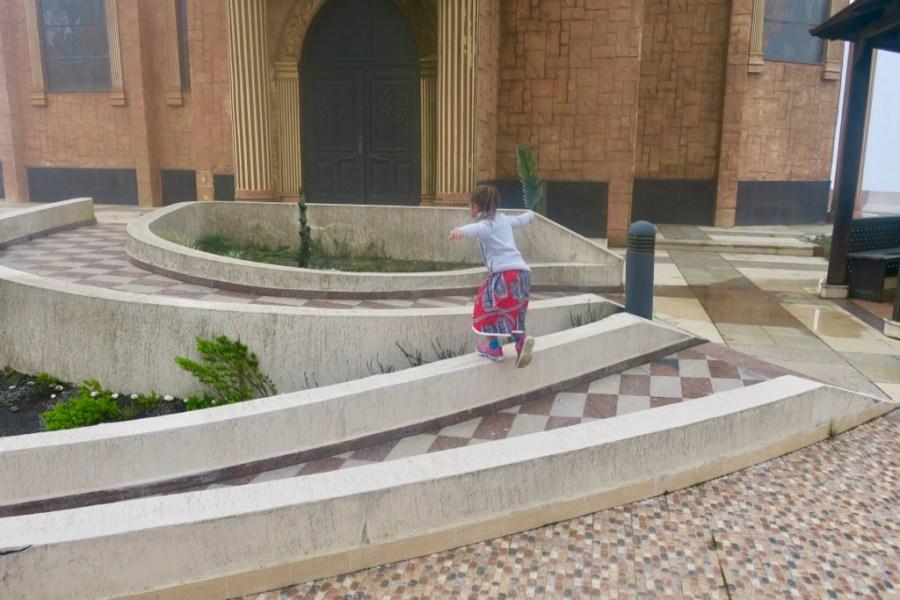 Jasmine running around the church at Pico Basilé, Bioko Island, Equatorial Guinea