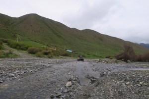 Driving through a river on our way to Kaindy Lake, Kazakhstan