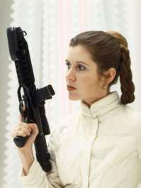"""13. Princess Leia: She just might have been one of the few women in a galaxy far, far away, but at least she was doing sh*t. She was one of the only people to outright insult Darth Vader and retain all her extremities. Not to mention, she was running a multi-system rebellion against the Galactic Empire at age 19, disguised herself as a bounty hunter, and strangled a morbidly obese crime lord who had taken her as a sex slave. In the Expanded Universe novels, she also trains to be a Jedi. It kind of makes you wonder, """"What the f*ck did you do today?""""."""