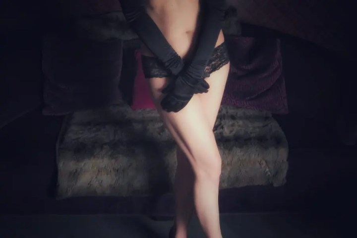 Wearing long black gloves and black knickers