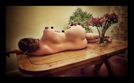 Nyotaimori - copyright Purple'sGem - picture of Gemnaked on a table decorated with sushi