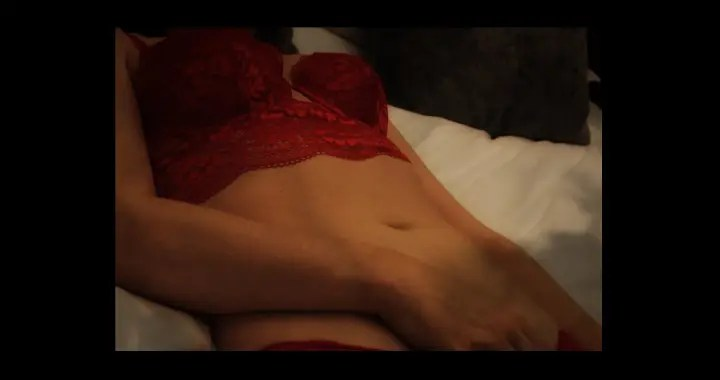 The power of touch - woman on bed with lingerie touching herself