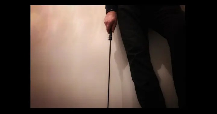 man with cane in his hand