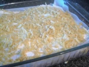 strawberry meringue cake - last layer of shredded dough
