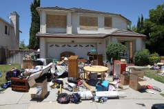 ANTIOCH, CA - JUNE 14: Furniture and personal belongings sit in front of a house that appears to be abandoned on June 14, 2012 in Antioch, California. May foreclosure filings surged 9 percent to 205,990 filings, including default notices, scheduled auctions and bank repossessions. The spike is the first monthly increase since January. (Photo by Justin Sullivan/Getty Images)