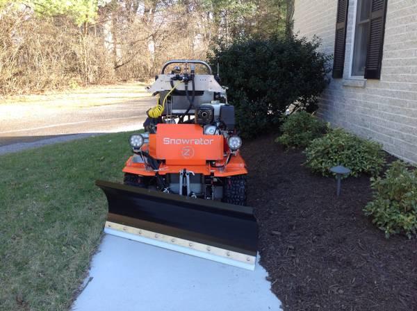 "Sidewalk operations -- a Snowrator ZX4 can easily fit down 36"" sidewalks"