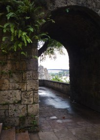 A stone archway with the view of the river
