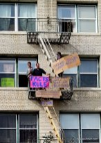 """Dudes on fire escape with signs: FACTS RULE, and """"Make Signs Great Again"""""""