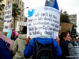 Womens March protest sign shows Trump's Tweet sayhing We have to march on Washington