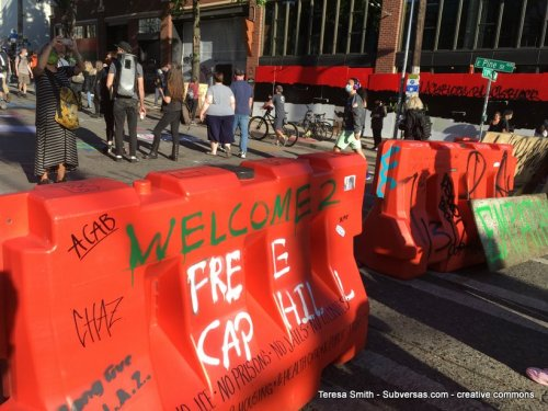 """Barridade painted """"Welcome to Free Cap Hill"""""""