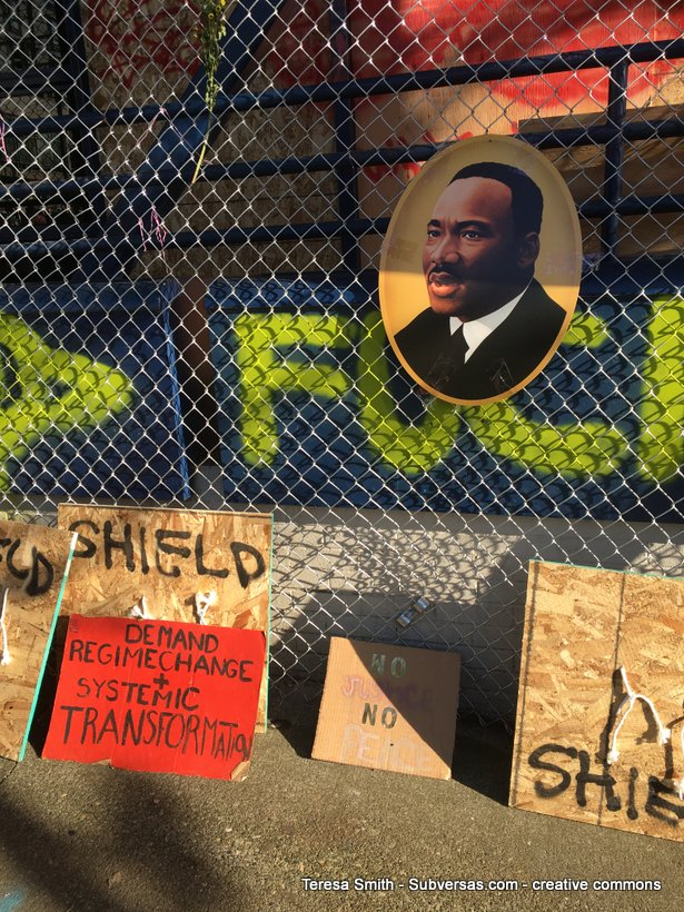 various signs and MLK art at Capitol Hill autonomous zone