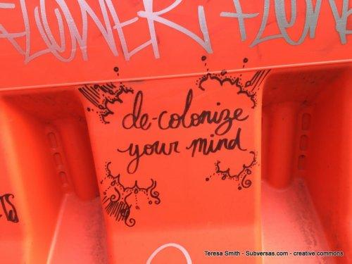 decolonize your mind graffit on barricade
