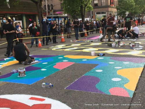 """Giant """"E"""" in Black Lives Matter"""" mural being painted."""