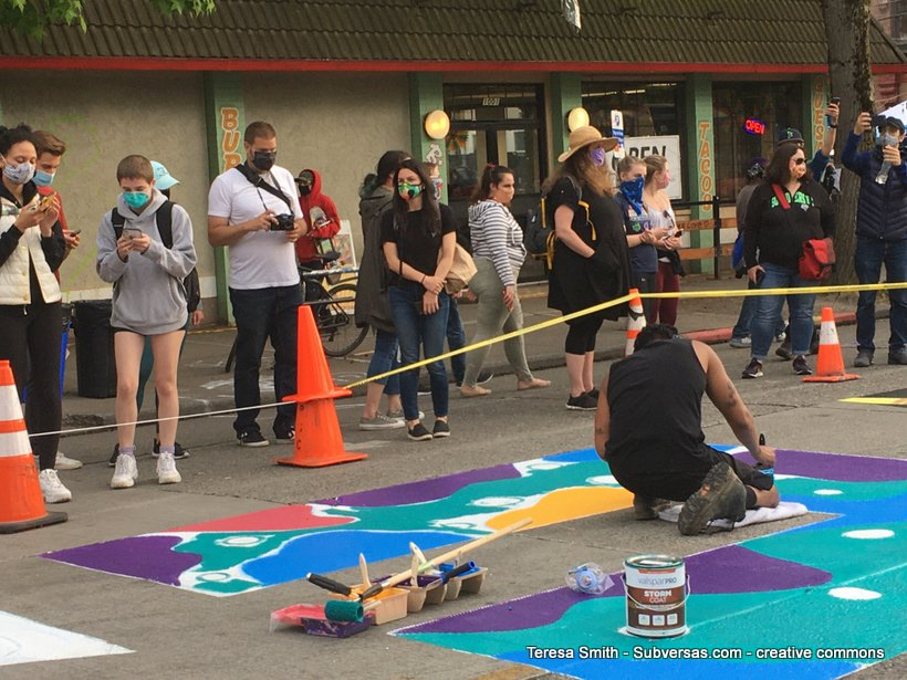 artist painting BLM mural