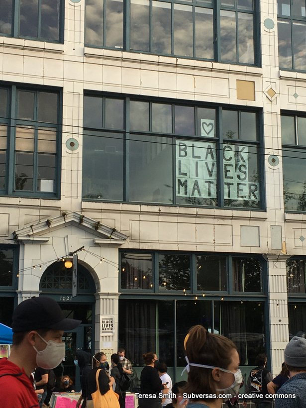 black lives matter sign in window CHAZ