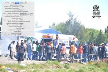 [Foto 11] 11:26:11 a.m. La ambulancia carga a varios heridos, entre ellos a Ancelmo Cruz Aquino.