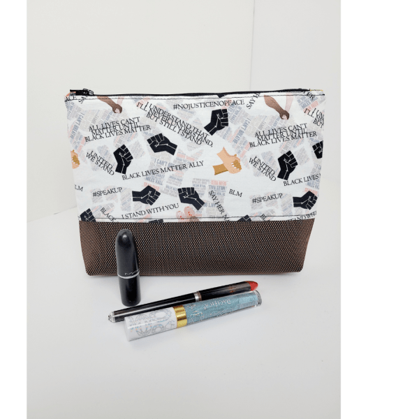 Full image of Black Lives Matter Allies zip pouch with pens and lip products for scale