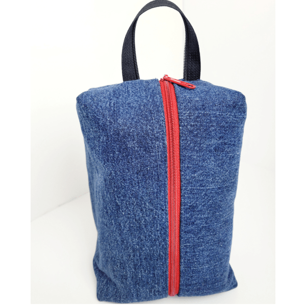 Upcycled denim boxy pouch, dopp kit with red zipper and a lining made from a classic star wars shower curtain