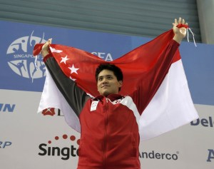 28th SEA Games Singapore 2015 - OCBC Aquatic Centre, Singapore - 8/6/15 Swimming - Men's 50m Freestyle - Final - Singapore's Joseph Schooling celebrates winning the gold medal SEAGAMES28 TEAMSINGAPORE Mandatory Credit: Singapore SEA Games Organising Committee / Action Images via Reuters