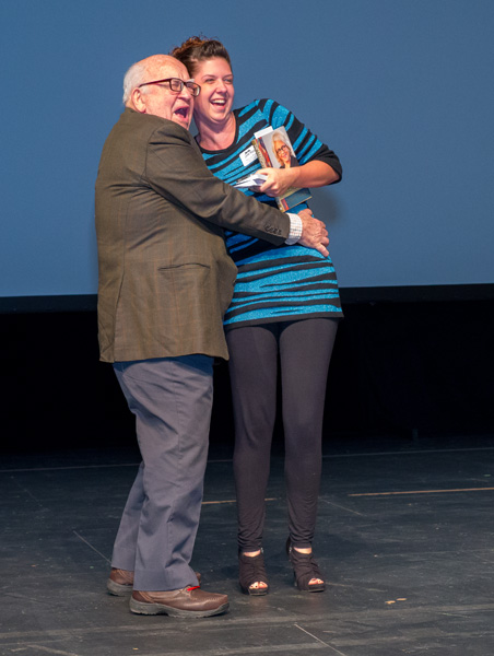 marin with ed asner getting on stage image