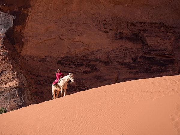 effie yazzie on horse at monument valley