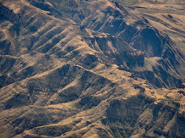 airline window view of desert photo