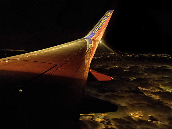 southwest wing over clouds