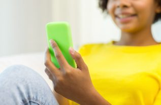 Black Teen on Cell Phone