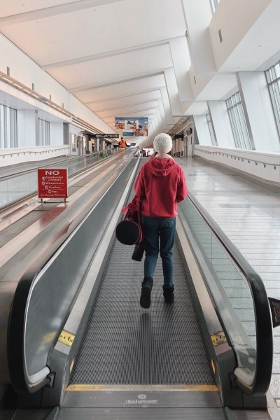 Taking the moving walkway at the airport.