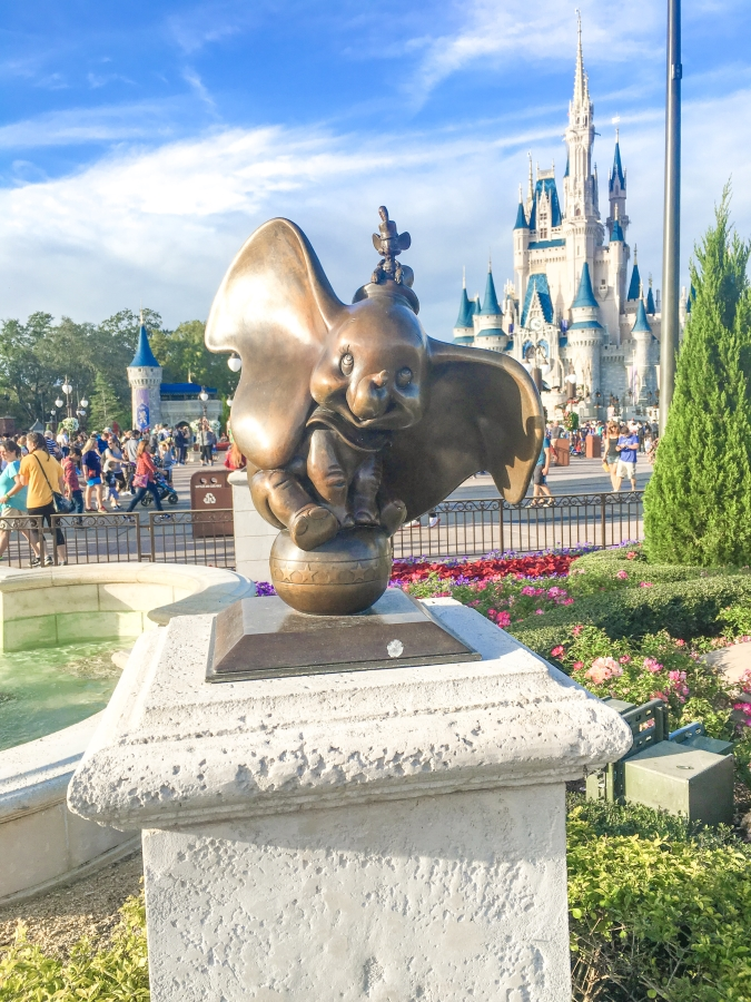 Dumbo statue in front of Cinderella's castle at Walt Disney World.