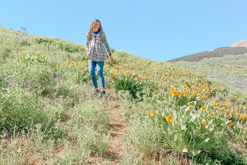 Me smiling in the wildflowers.