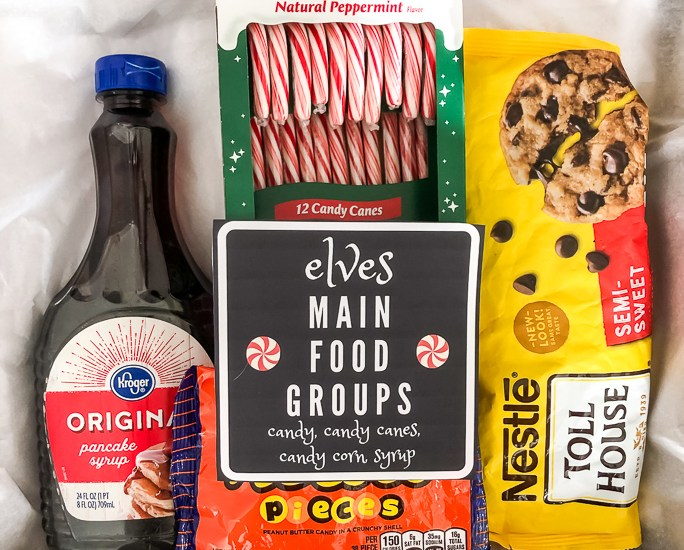 Elves Main Food Gift Basket. Candy, candy canes, candy corn, and syrup.